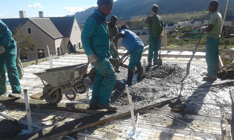 Pouring concrete over precast decking