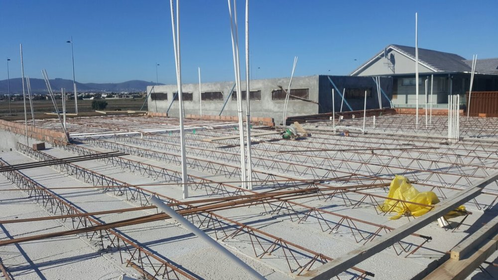 Plumbing and electrical systems have been installed before casting the Cobute decking system.