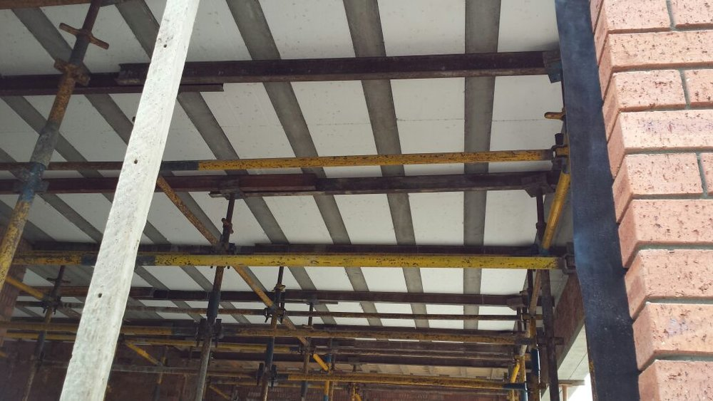 Precast ribs with steel reinforcement and polystyrene blocks.