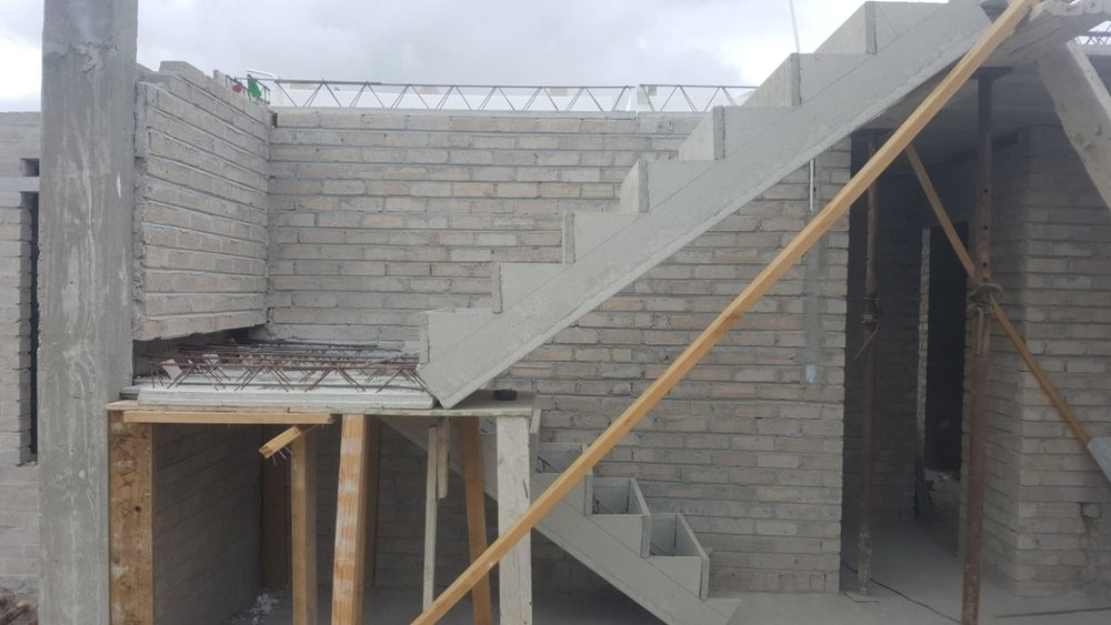 Cobute precast stairs with landing between the flights.