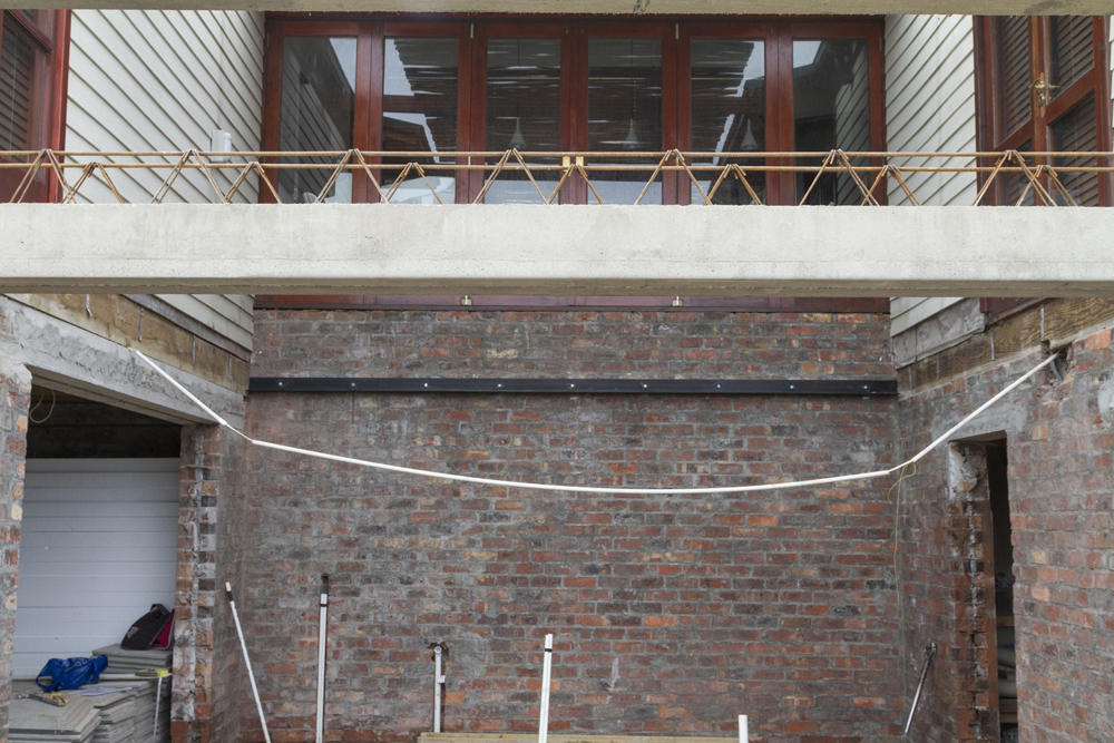 Precast beam for the creation of a balcony
