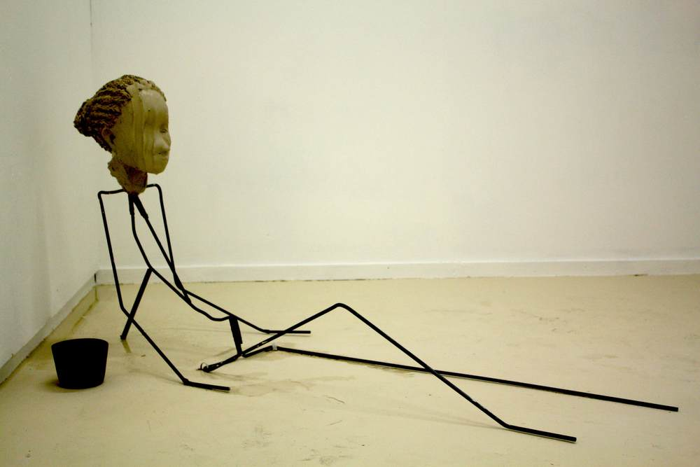 Furrows (2013) is a performance combined with sculpture.