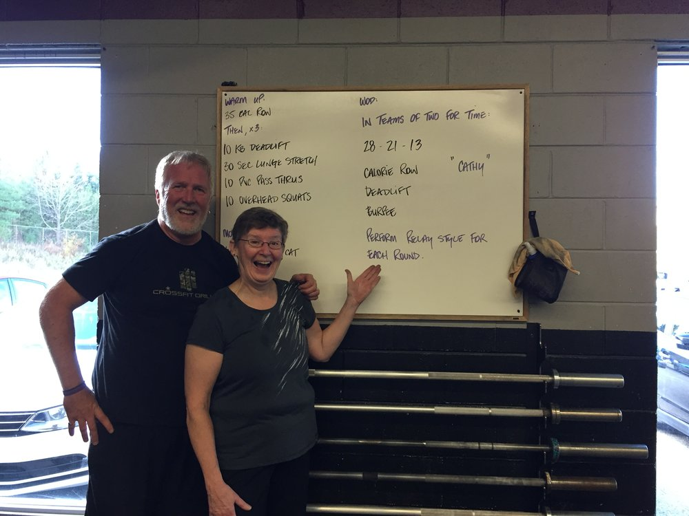 "Cathy and Mike after completing the WOD ""Cathy""!  Great job to everyone for tackling this one!"