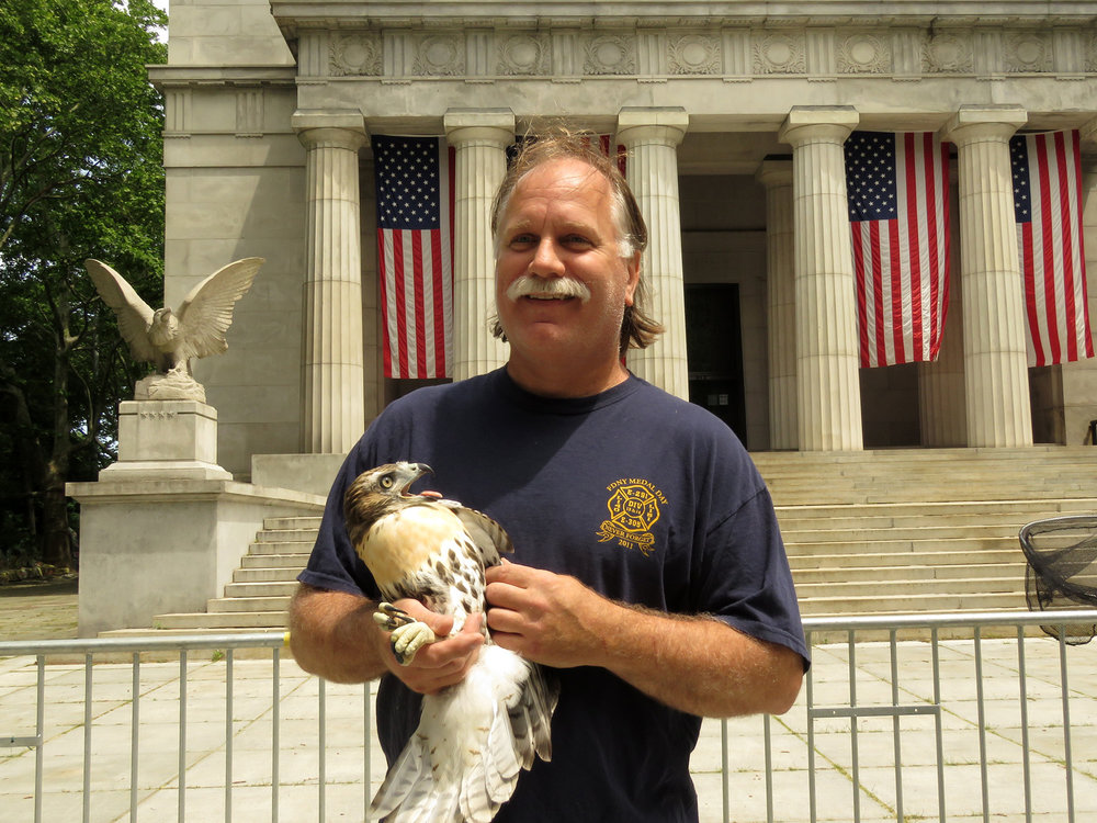 Bobby Horvath of WINORR with the first fledgling to be rescued, on June 11, 2018.