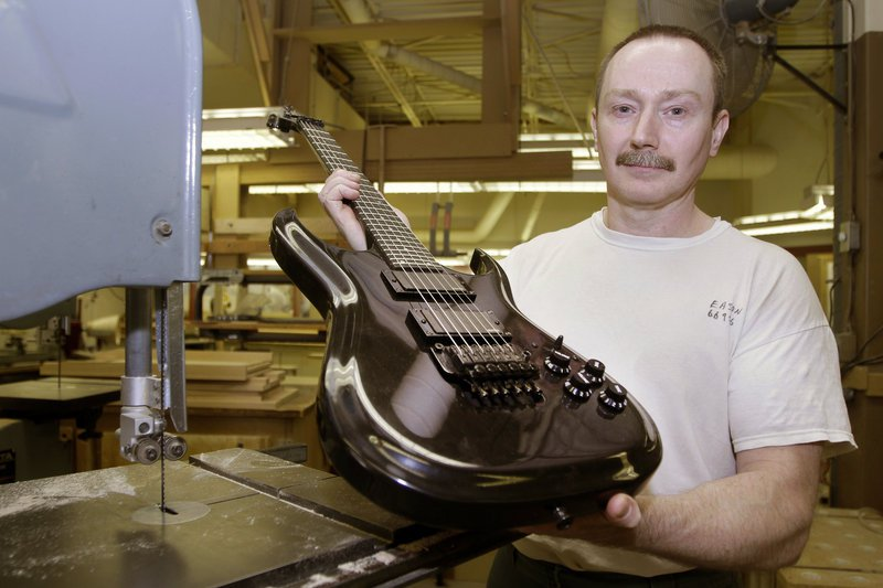 Allen Eason Poses With A Guitar He Made. Eason Is A Master Furniture Maker  And