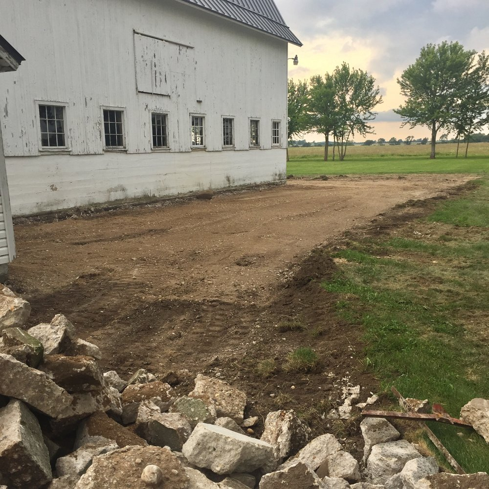 Eastern side of the barn, parking area.