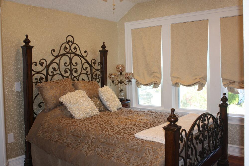 The Verona Room has a queen bed
