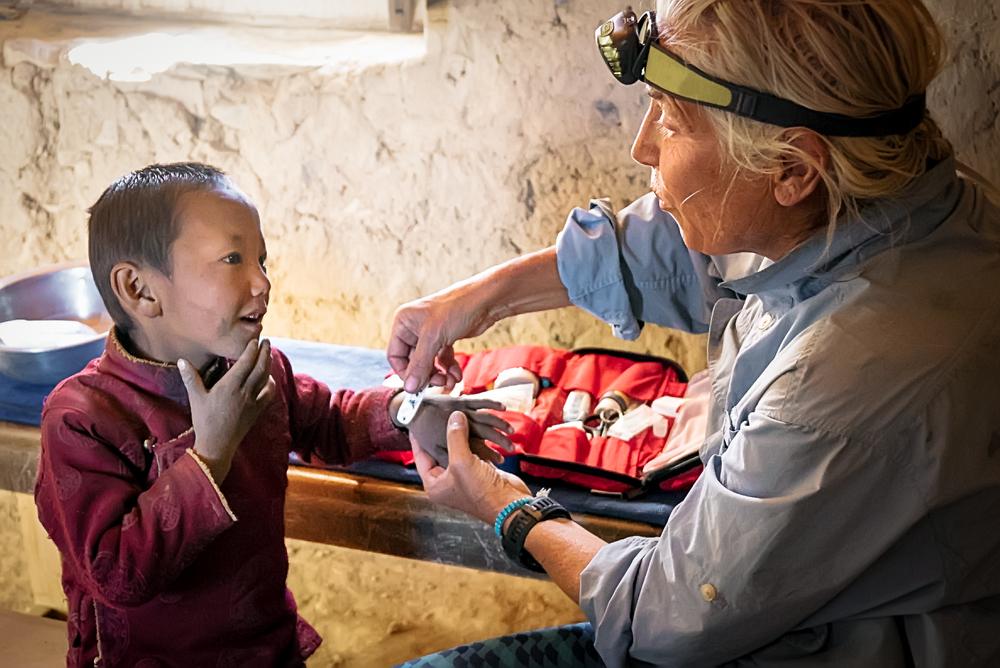 CiraCrowell_Nepal_20151002_Julie Treats a Boy, II.jpg