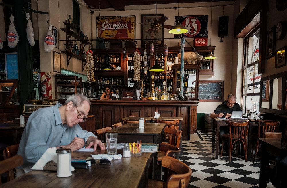 45. Two men busy sketching, El Hippopotamo, San Telmo, Buenos Aires, Argentina.