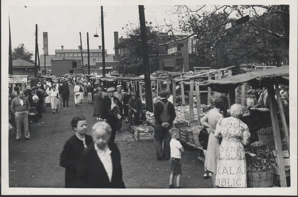 "The Kalamazoo City Market on Mills Street, 1936-1941. The original caption reads, ""Kalamazoo City Market for farmers to sell produce""."