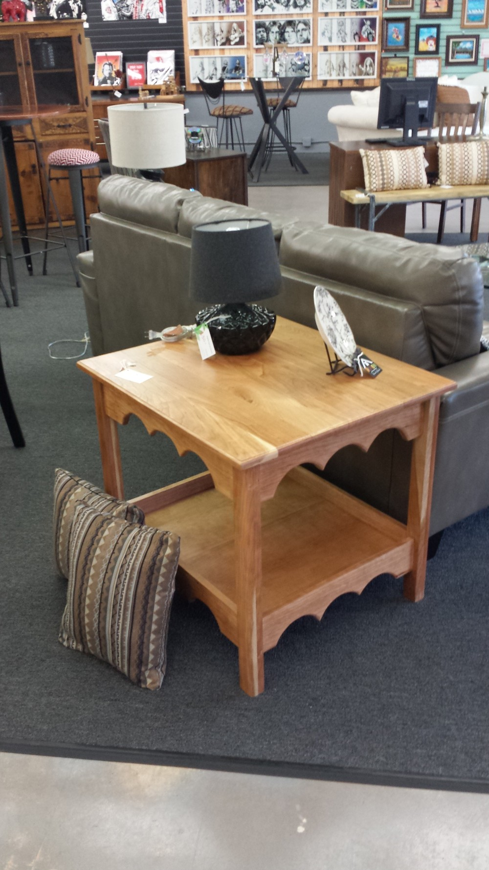 Customizing furniture is one of my passions by incorporating different woods.  I visualize unfinished wood and place my signature on it. The construction is made to last by using processes like joinery. The picture above is a side table made from cherry wood (currently being displayed at Blue Chair located on Broadway in Denver.) The  black shelf below is made from pine and stained with Jacobean stain is also on display in my own retail space with other masterpieces.
