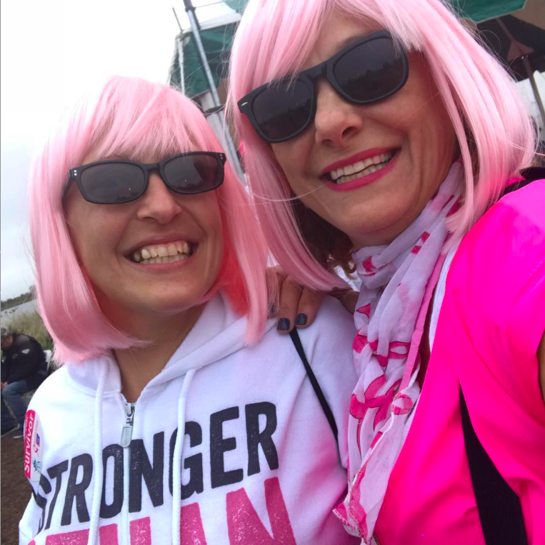 Barbara and a friend rocking their pink wigs at a Breast Cancer Research Walk.