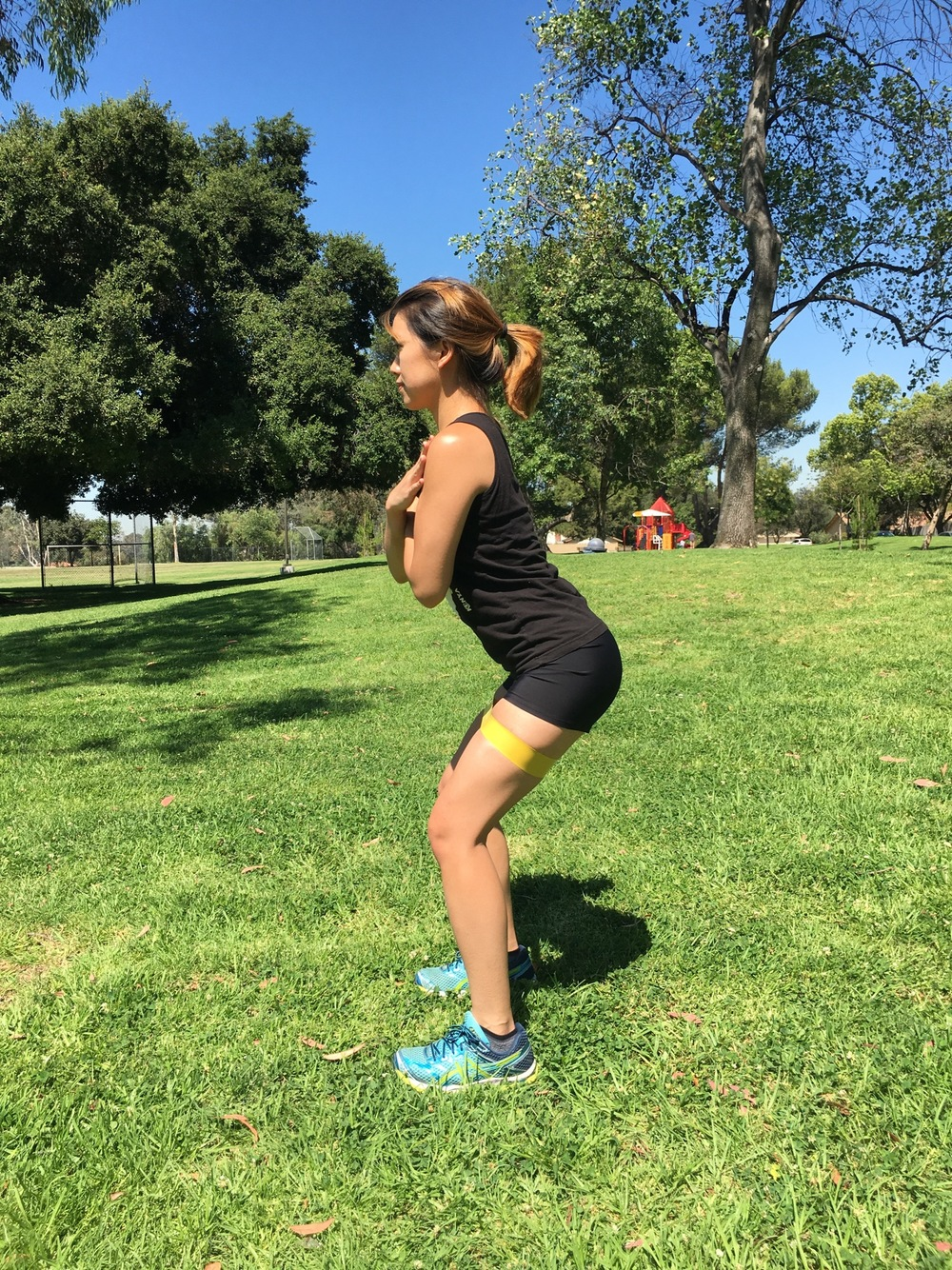 Step 1: Starting position lateral view. Make sure your knees are behind the front of your toes,your back is straight with your core contracted, and your bottom is back as if you were trying to sit.