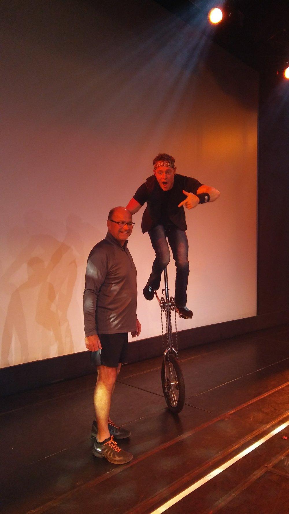 unicycle with volunteer.jpg