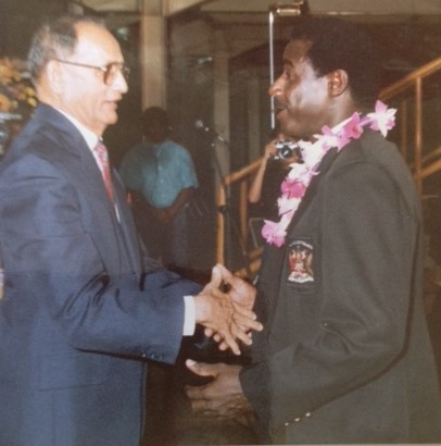 "President Noor Hassanali congratulates Everald ""Gally"" Cummings for being inducted into the Trinidad & Tobago Sports Hall of fame (1989)."