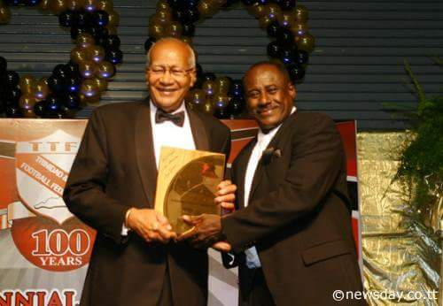 "President Max Richards presents Everald ""Gally"" Cummings with a lifetime achievement award for his outstanding contribution to T & T football at the TTFF 100th Anniversary Celebrations (2008)."