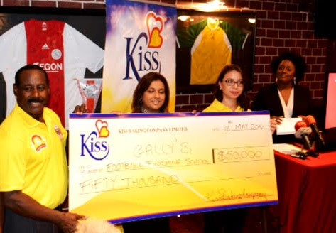 GFFS Platinum Sponsors, Kiss Baking Co., presents the GFFS founder with their sponsorship cheque.