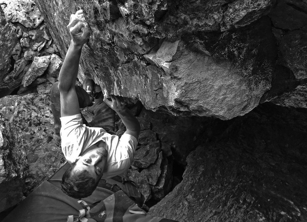 Nate climbing Genesis |V8|, a newish boulder in the Holy Cross Wilderness of Colorado.