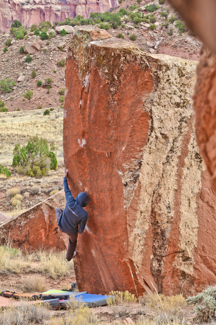 Attempting World's Greatest, a line that epitomizes the Indian Creek bouldering style. Photo by Nathaniel Davison.