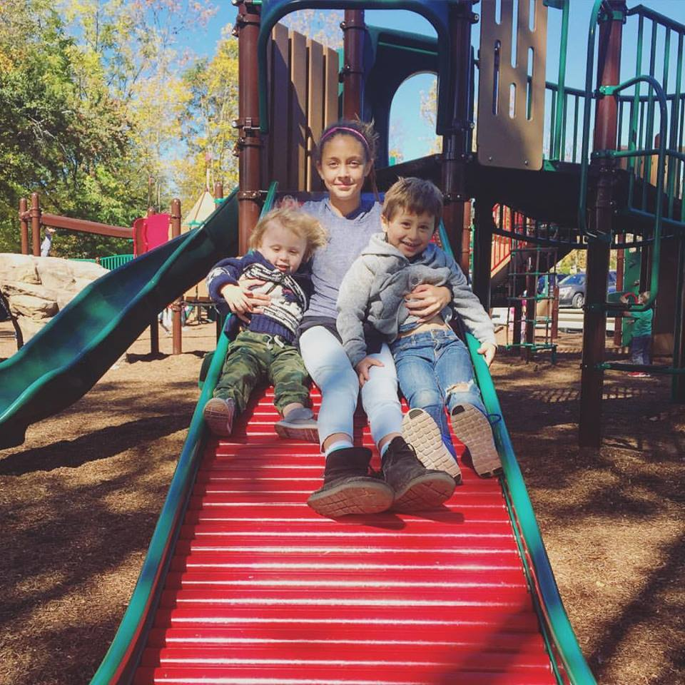 Simarah with her two brothers.