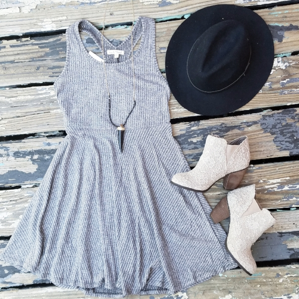 Sport this flirty summer dress while it's hot outside! Add a feminine trench coat and leggings once the cooler weather rolls in.