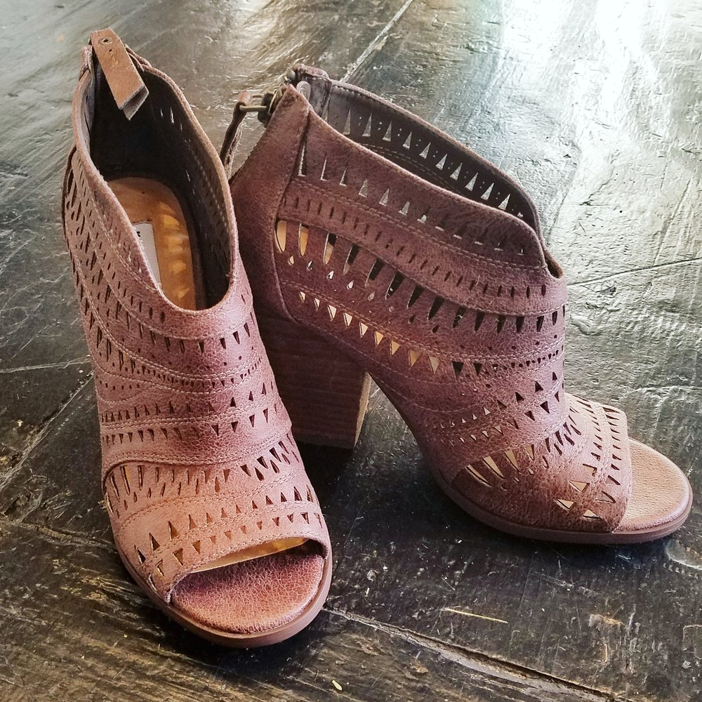 This sandal pairs with everything! The unique cut elongates your legs while keeping a low profile heel.