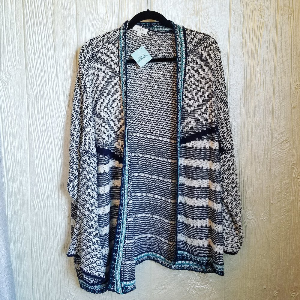 Can't you see yourself cuddling up in this sweater with a cup of tea and a great book at your local coffee shop? We love the neutral grays with a tiny pop of teal!