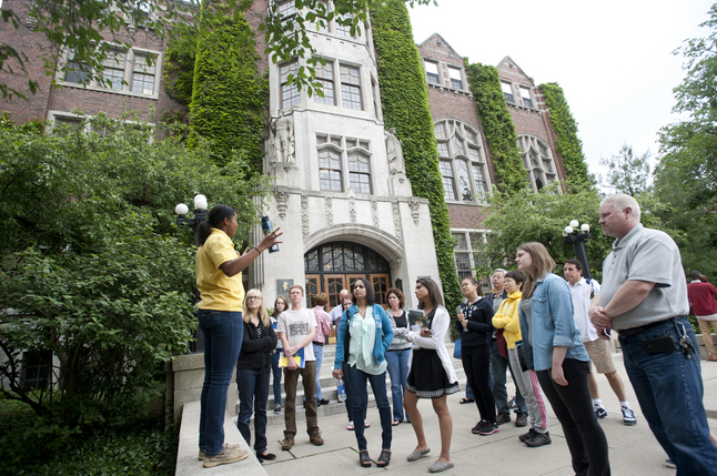 University of Michigan junior Jillian Jackson leads a tour of prospective students and their parents outside of the Michigan Union. Melanie Maxwell | AnnArbor.com