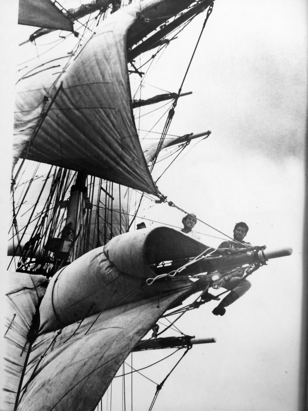 """Drake Thomas (1942 -) at the end of the yard on Endeavour II.Drake has sailed throughout the Pacific on barkentines and schooners, and also served on Coast Guard cutters. From Panama to Australia, from the Galapagos to the Bering Sea, he has spent decades navigating the high seas. He served as Master of the Brigantine  Rendezvous , was responsible for the restoration of the Baltic schooner """" Carthaginian """" in Lahaina, Maui, and also built thesquare-rigged sailing packet  """"Hawaiian Chieftain """" (launched in 1988)."""