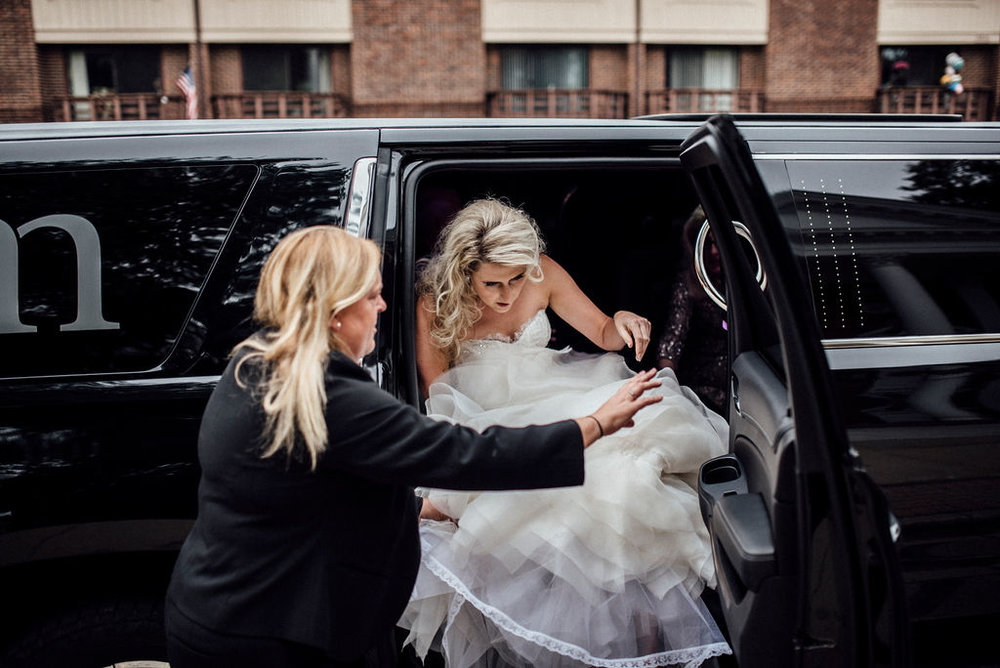 Helping my Chicago bride get out of her limo the right way (feet first, train off the ground)