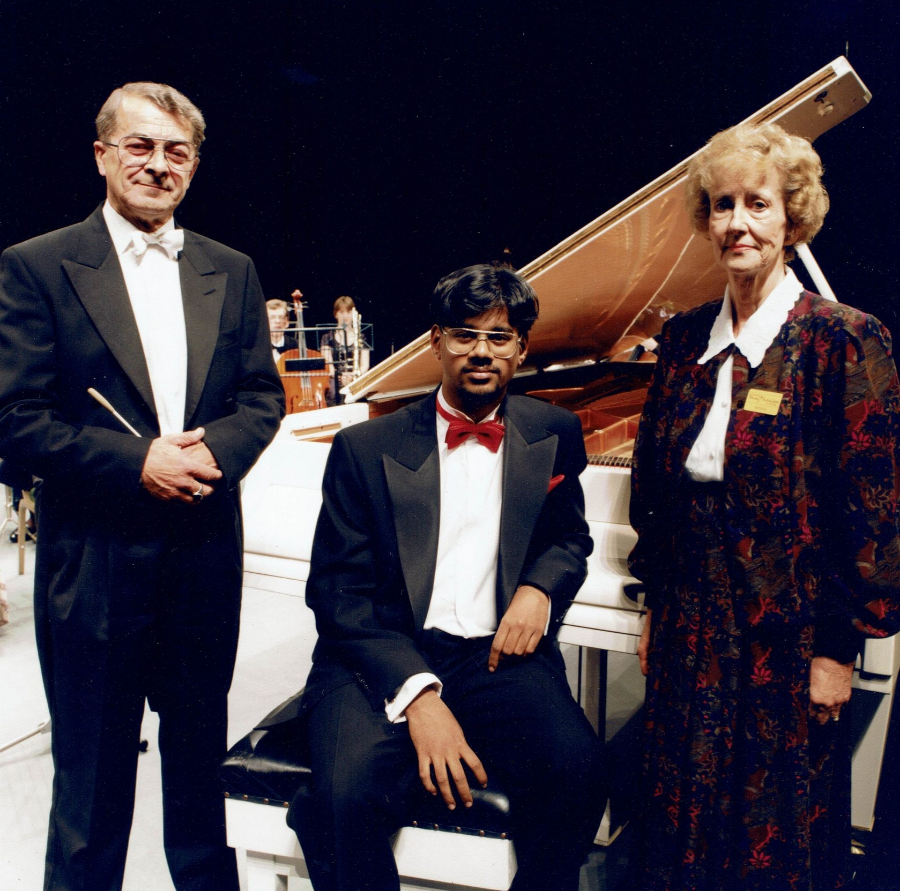 Barry Griffiths (conductor) and June Clements with the inaugural winner of the SYMY.