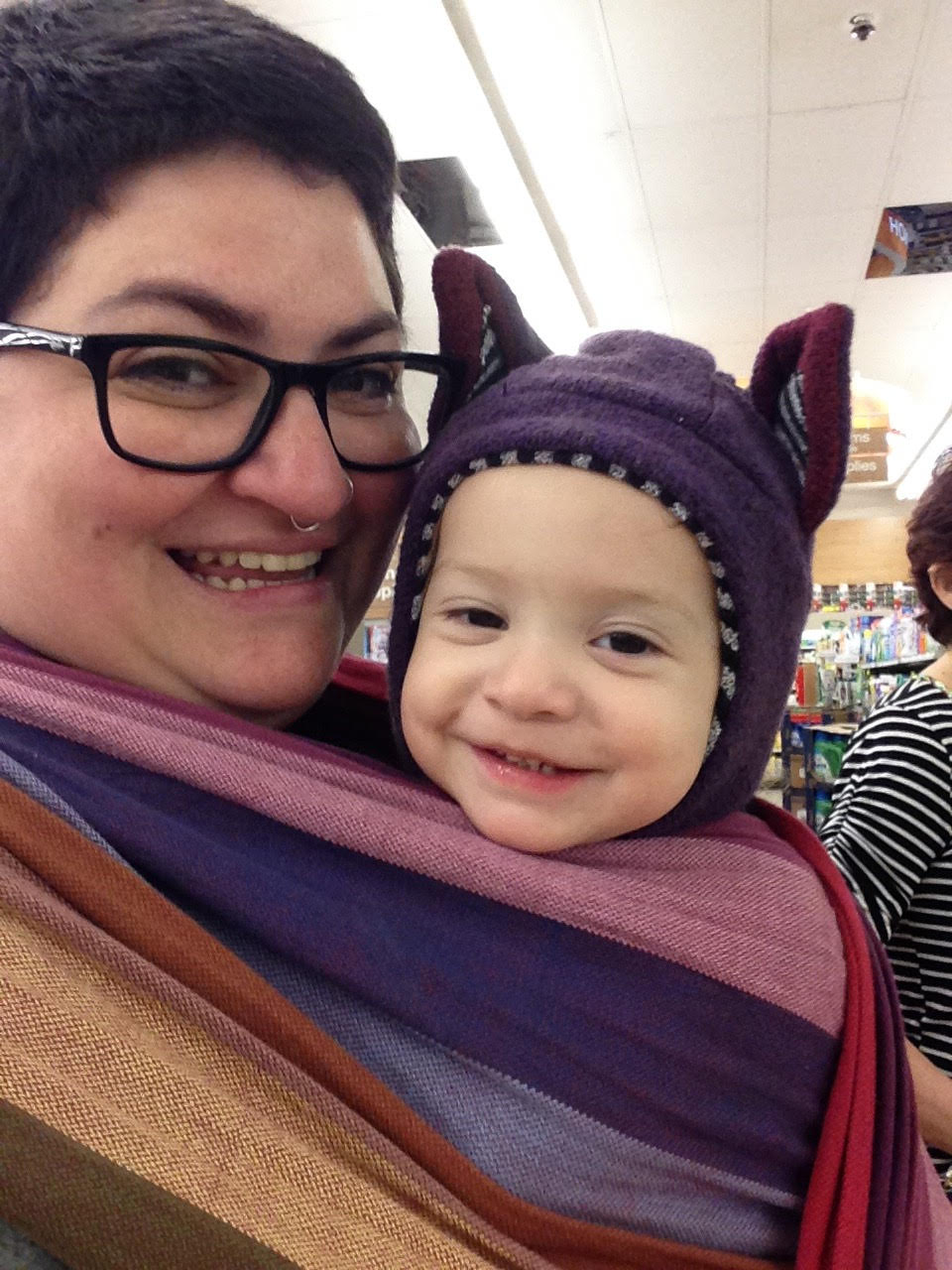 Stephanie wearing her little one, Olive, in a woven wrap