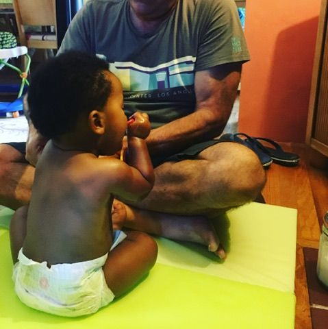 Tammy's client massages his baby