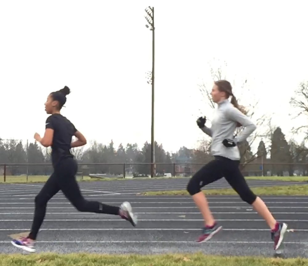 Pictured above: Serena Smith of Union HS (left)  and Paige Neff of Camas HS (right) train together on a frigid winter day in January of 2017.  Paige was named Runner of the Week for her two lifetime best 1-mile races to start her season.