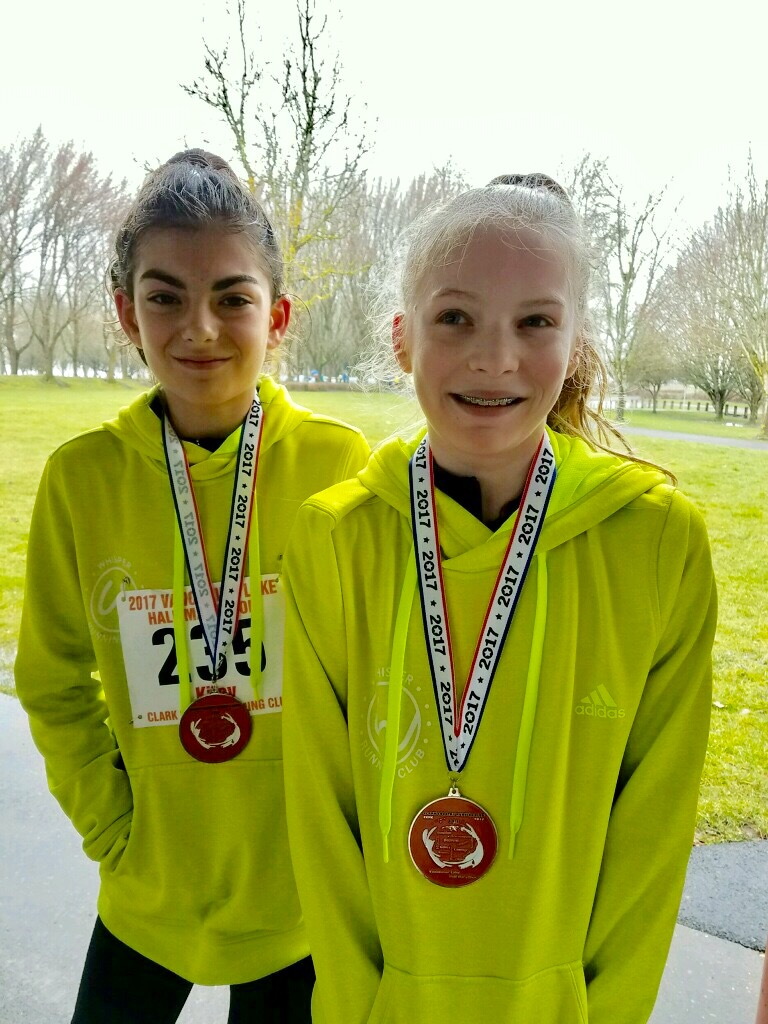 Kiley (left) and Katelyn (right) after running the Vancouver Lake Half Marathon, where they finished 1st and 2nd in their age group with times of 1:49:43 and 1:49:49.