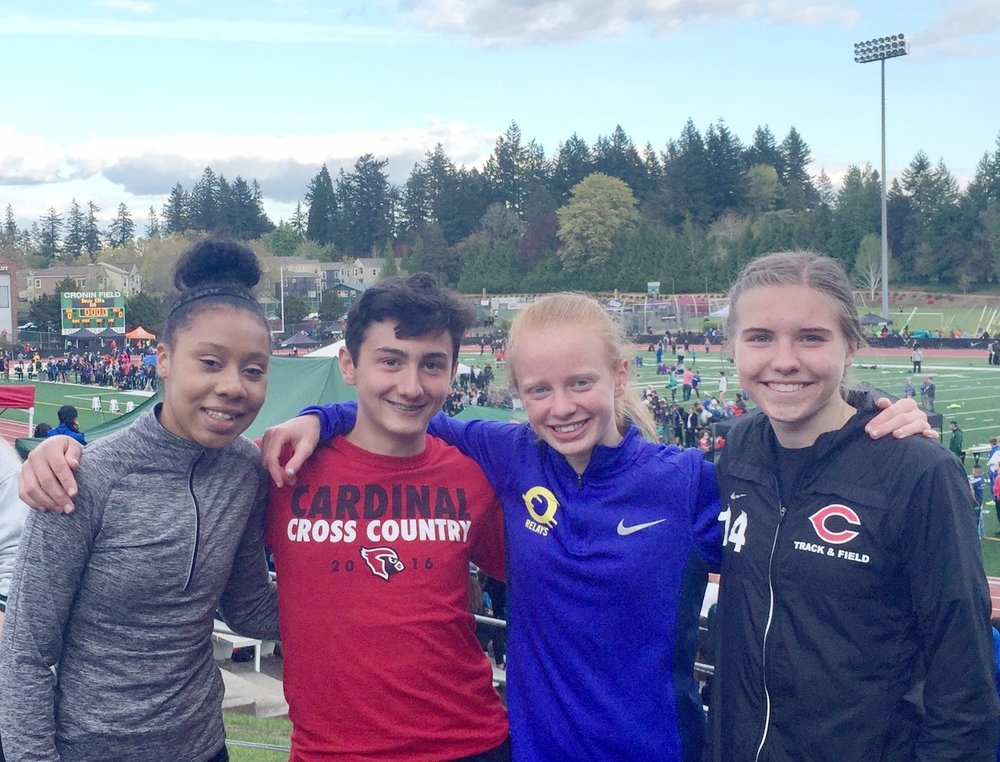 Hands-down, the best part of working with Whisper runners is to watch them compete with one another, meanwhile representing their respective schools. Here, Serena (Union HS), Ethan (Lincoln HS), Amara (Central Catholic HS) and Paige (Camas HS) take a brief moment to catch-up and take a picture, prior to their participation in the Jesuit Relays.