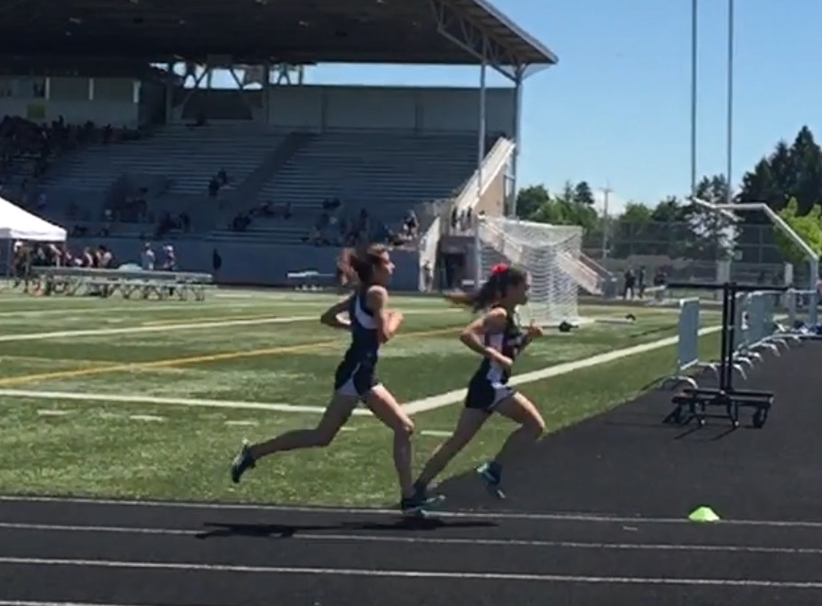 Photo from the Greater St. Helen's District Track & Field Meet where Kiley (left) placed second in this race, the 1600m dash.