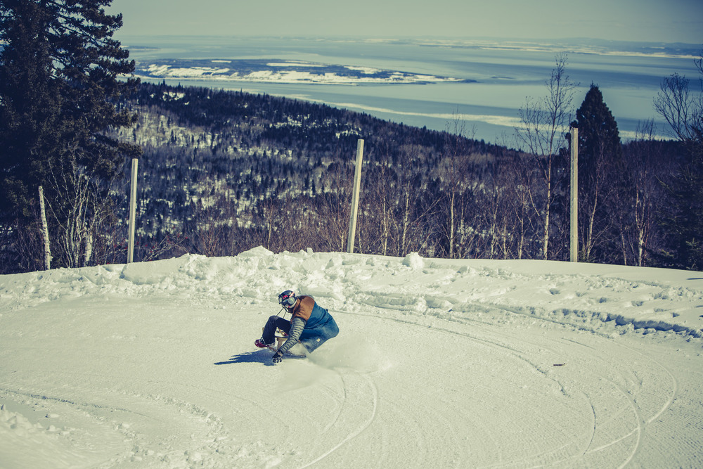 Pulling some G's around a turn on the rodeling track at LeMassif, QC