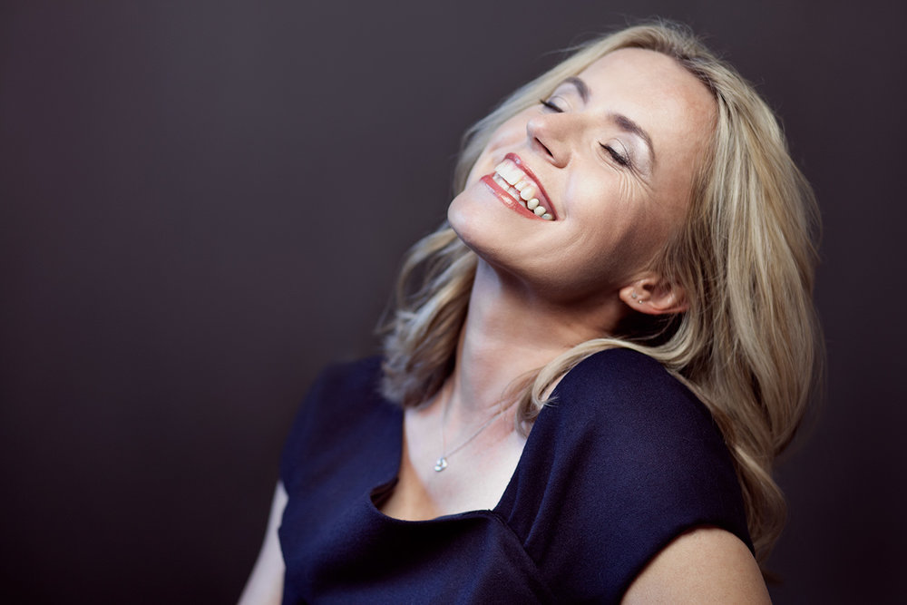 portrait-of-a-woman-laughing