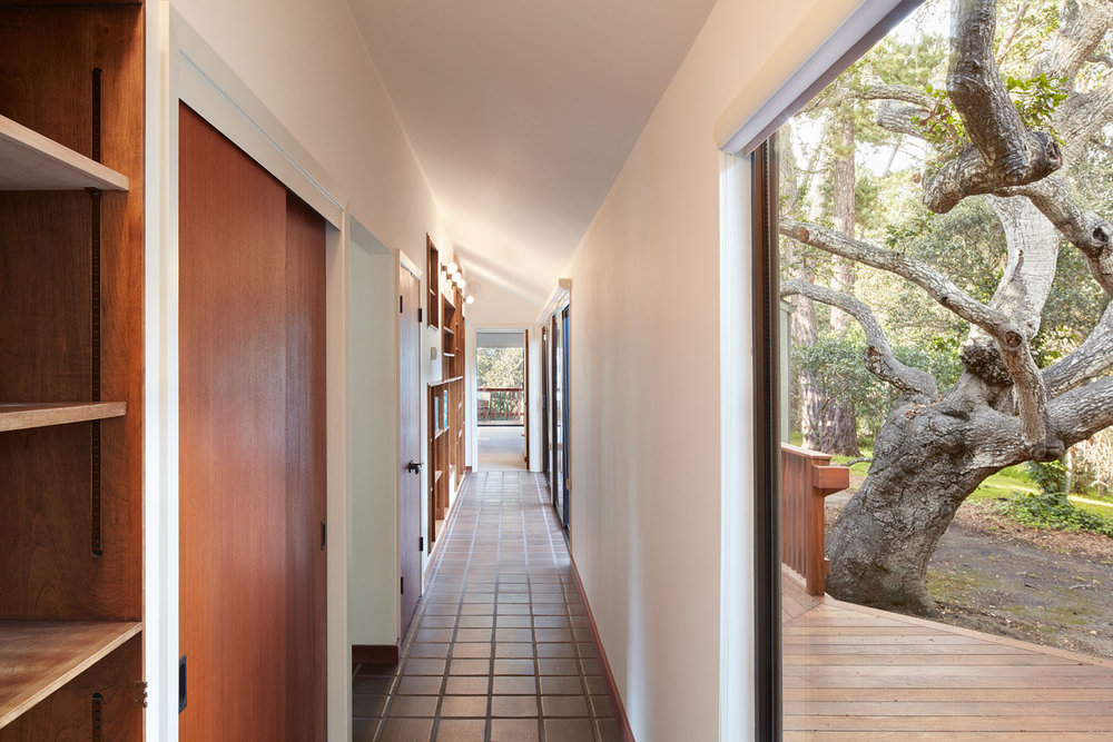 Hallway with bookcase and outdoor view