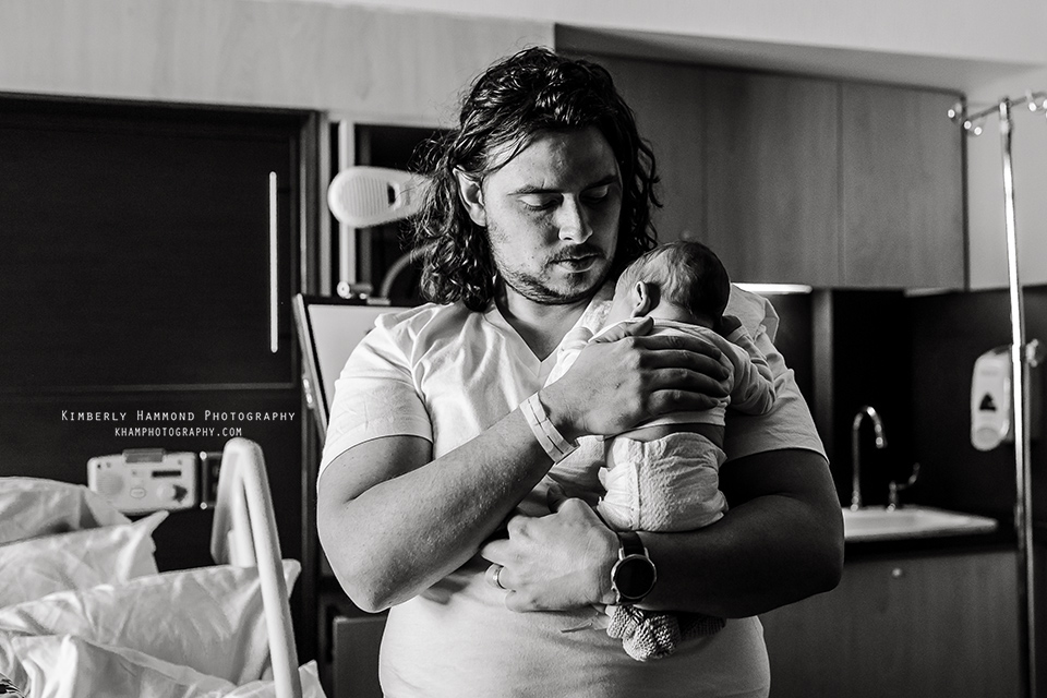Father and new baby bond after birth at Baylor Medical Center in Dallas TX.