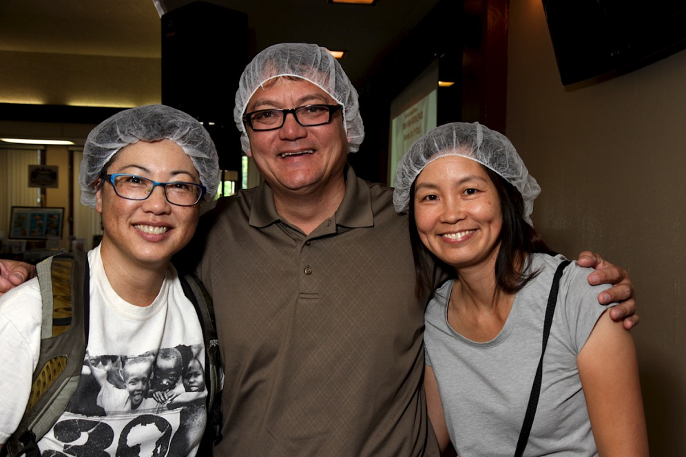 While packing food, hair nets are required and provided.
