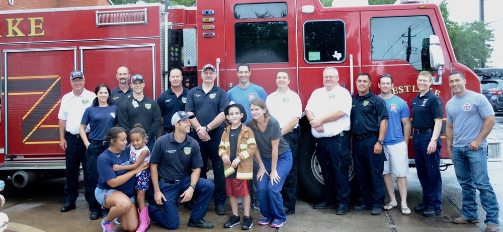 Members of the Westlake Fire Department helping with Make-A-Wish.