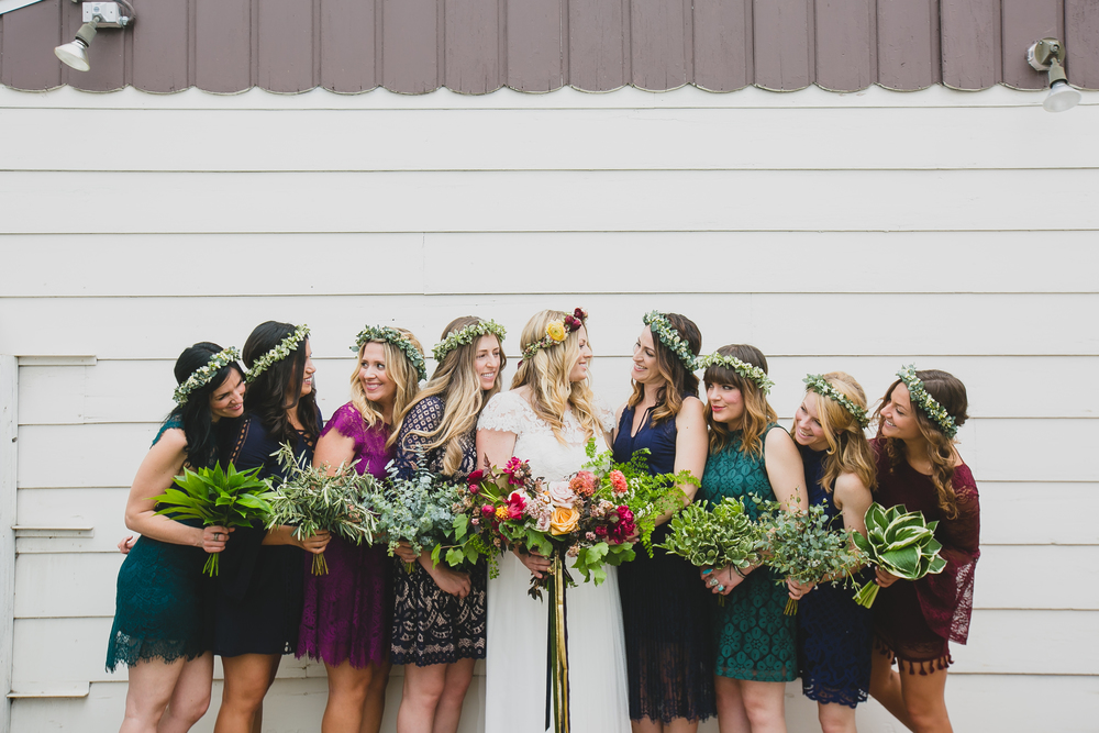 I wanted a bohemian feel for the bridesmaid dresses in jewel tones. Each girl chose their own lace dress and had a bouquet and flower crown of greens.