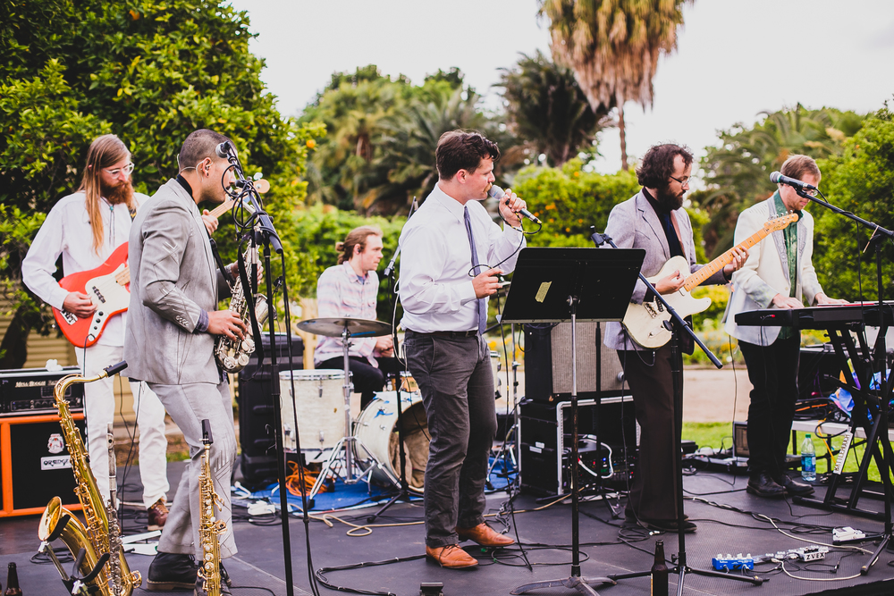 We had my brother-in-law's band  Battlehooch  play live music and MC for the reception. They were so good and the live music just added to the energy of the event.