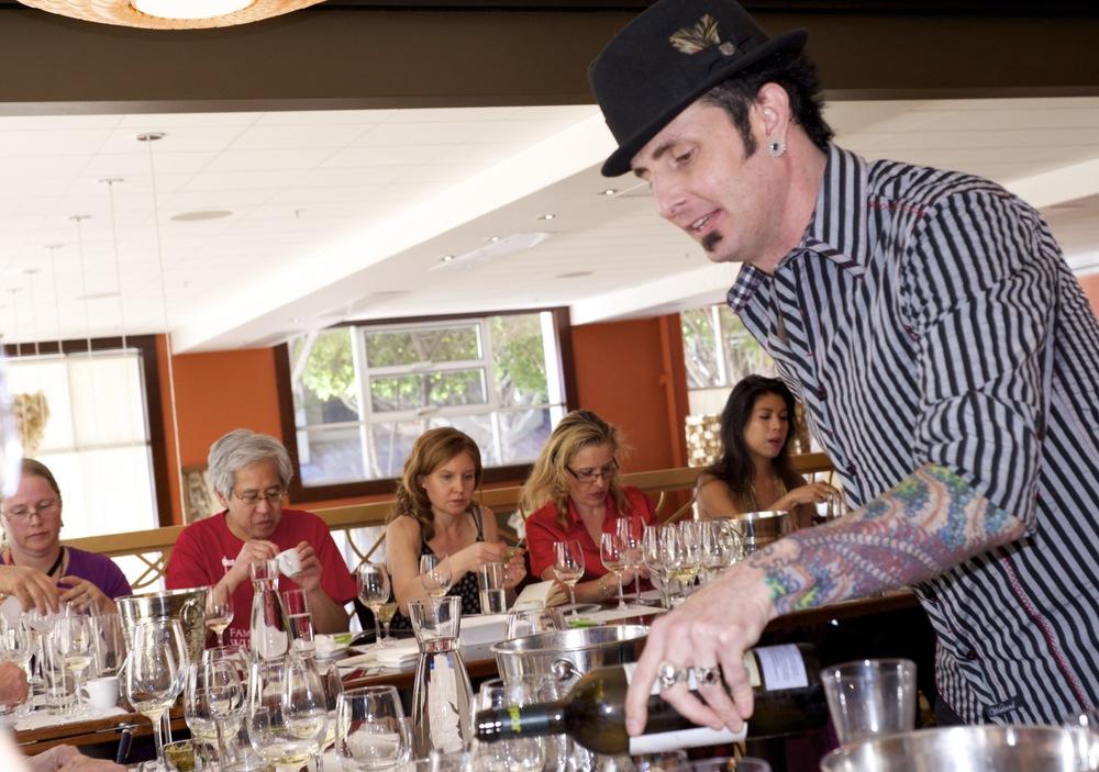 Sommelier Todd Smith hosting Rueda wine tasting,demonstrating Indian food pairings.