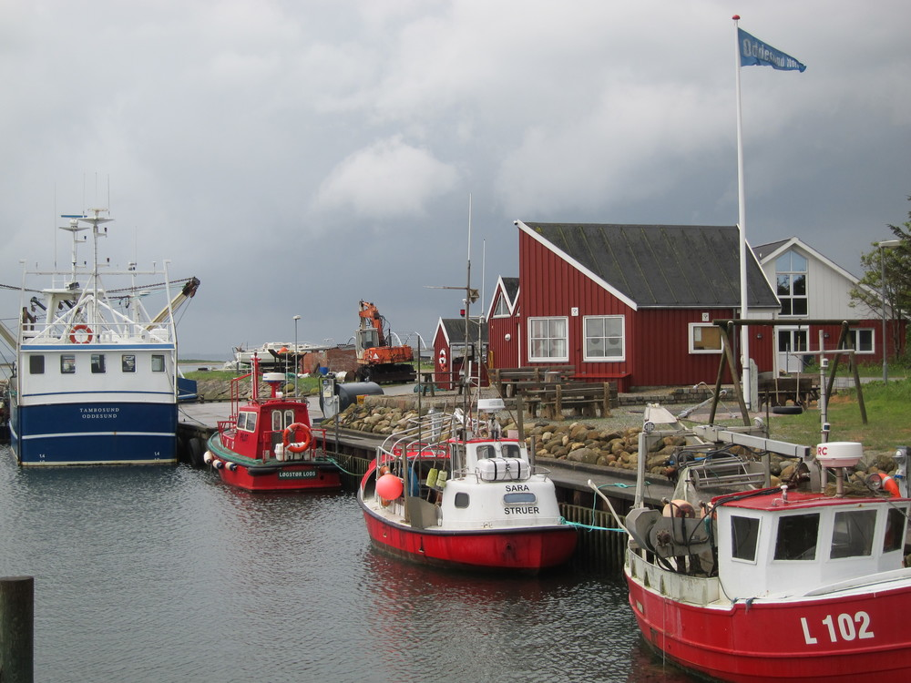 Fishing boats in a tiny harbor town on the island of Jutland, Denmark.