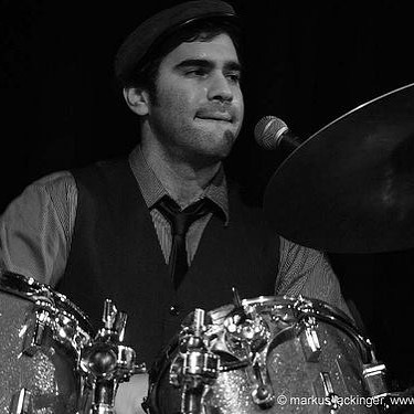 """Meet Cosa Nostra. Aaron Kierbel plays: cajon, typewriter, frame drum, shakers, triangle, castanets (& so much more) & once took a """"drum"""" solo with a piece of paper. He can do it all. In perfect time. #meetcosanostra #cosanostrastrings"""