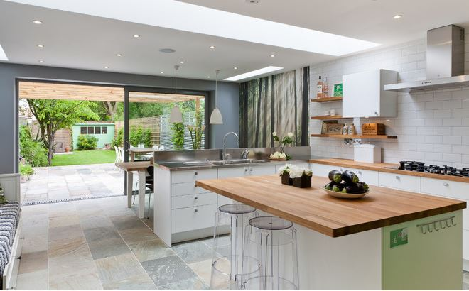 This Example Also Keeps The Kitchen Just Outside Of Extension Which Again Has Been Used For Dining Table But Where Three Simple Roof Windows Were