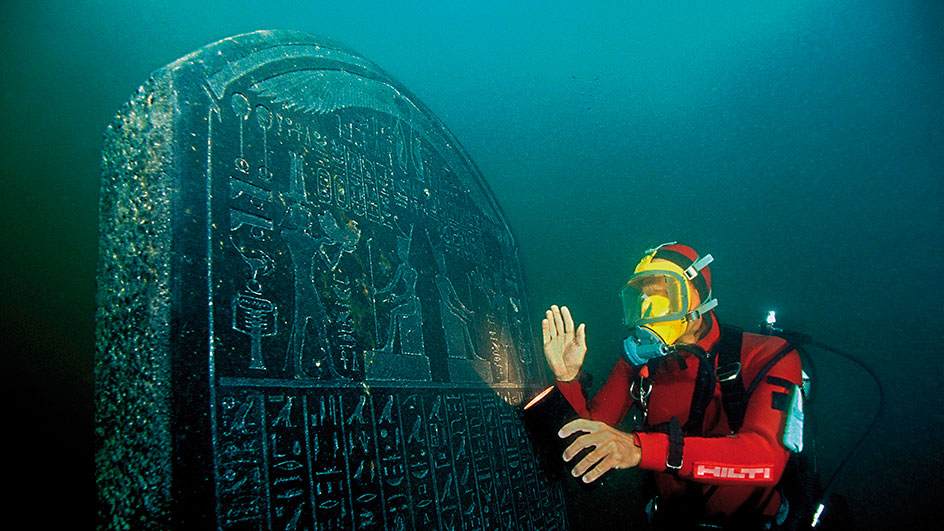 A diver shows a marble statue of Osiris